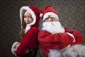 Santa Claus and Mrs. Santa are a very good team together.