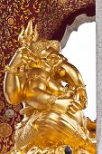 stock photo of laddu  - the golden ganesh god statue in thailand
