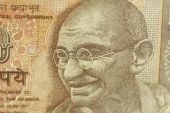 foto of mahatma gandhi  - macro photo of indian 10 rupee banknote depicting mohandas  - JPG