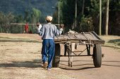 Farmer With His Shabby Cart Pulled By A Donkey, Ethiopia, Africa