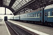 stock photo of passenger train  - Covered old railway station with train train - JPG