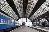 stock photo of passenger train  - Covered old railway station with trains - JPG