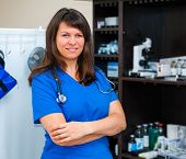 stock photo of vets surgery  - Young woman vet doctor portrait in clinic - JPG
