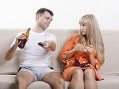image of rutin  - Couple sits on the couch - JPG