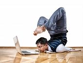 stock photo of locusts  - Indian businessman doing yoga and looking at laptop in the office at white background - JPG