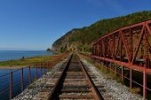 stock photo of transcontinental  - The Circum-Baikal Railway Bridge - a historical railway that runs along Lake Baikal in the Irkutsk region of Russia.