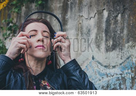 Pretty Girl With Long Hair Listening To Music