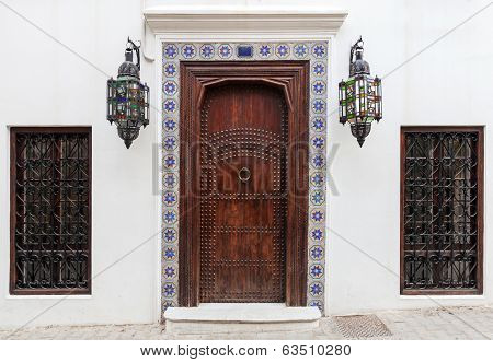 Ancient Wooden Door And Windows On White Wall. Tangier, Morocco