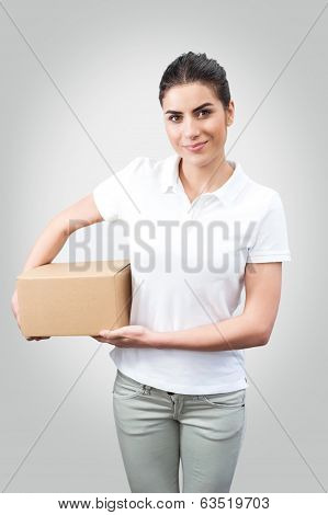 Delivery woman holding a box