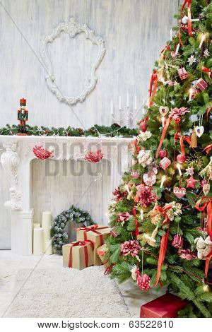 Room with decorative fireplace decorated to christmas celebration