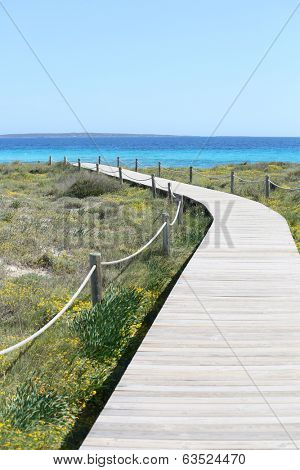 Wooden pathway going to beach of Formentera island
