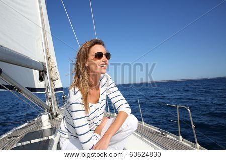 Attractive modern woman enjoying sailing cruise