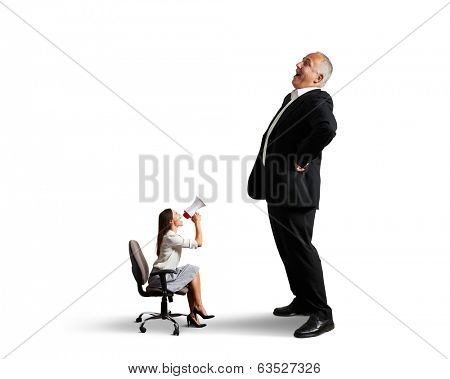 businesswoman screaming at big laughing businessman. isolated on white background