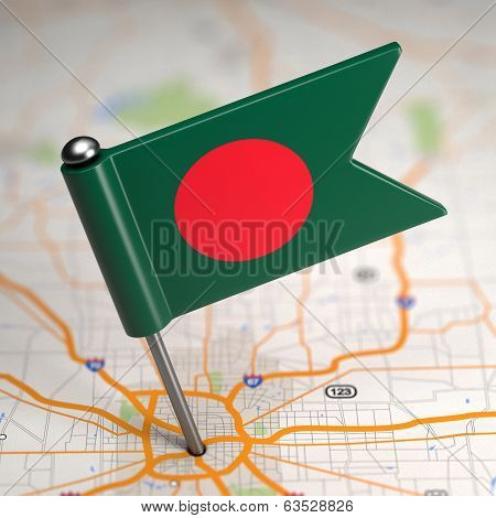 Bangladesh Small Flag on a Map Background.