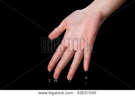 Human hand with water splashing on them on black background