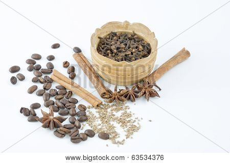Spices Per Pod And Scattered On The Table Beside.