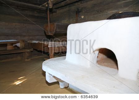 Historical Peasant Dwelling Interior With Stove