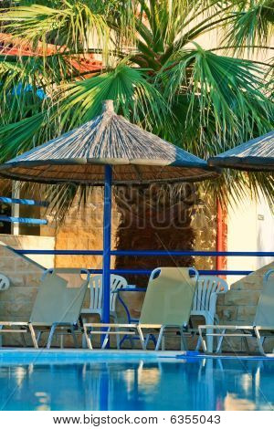 Swimmimg Pool And Umbrella.