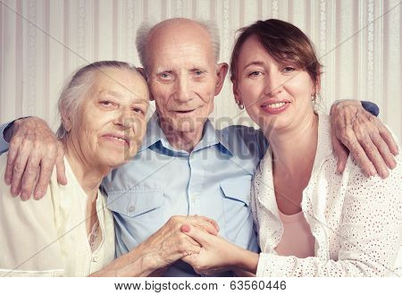 Senior man woman with their caregiver at home.