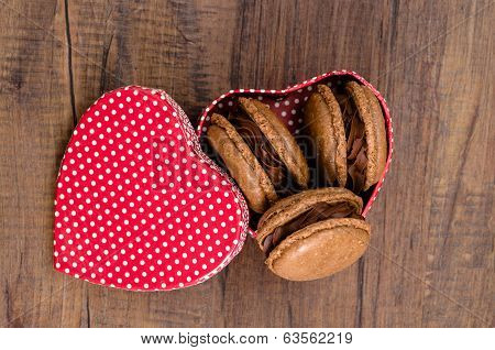 Red Heart With Baiser Macarons And Chocolate