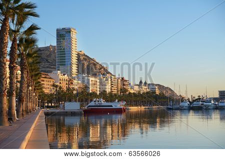 ALICANTE, SPAIN - JANUARY 8, 2013: Trip boats in port of Alicante. It's one of the most important ports in Spain for cruises, bringing some 80,000 cruise passengers and 30,000 crew to city each year