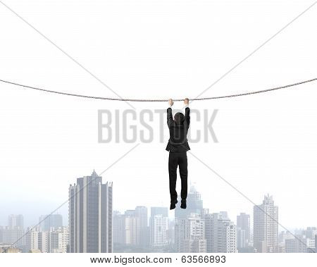 Holding Rope And Hanging  With City View