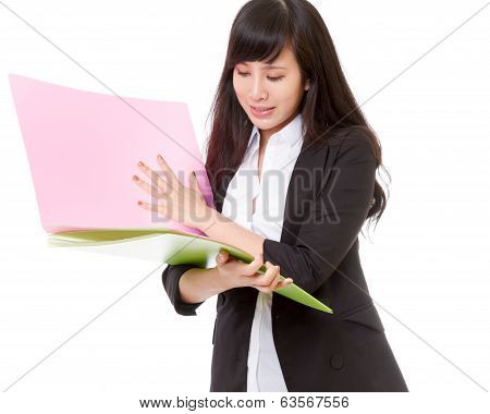 Asian Businesswoman Holding Bright Colored Folders