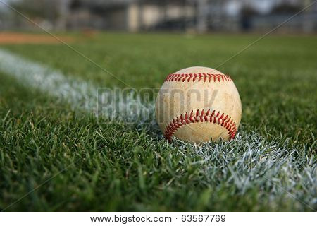Baseball on the Outfield Chalk Line with room for copy