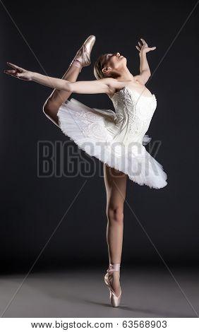 Image of flexible cute ballerina dancing in studio