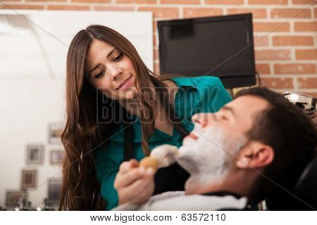 Happy Barber Shaving A Client