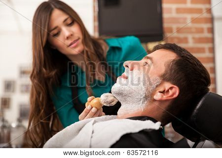 Female Barber Shaving A Man