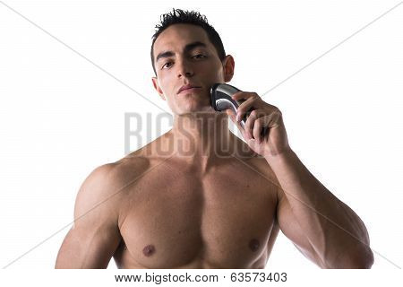 Muscular Man Shirtless Using Electric Shaver