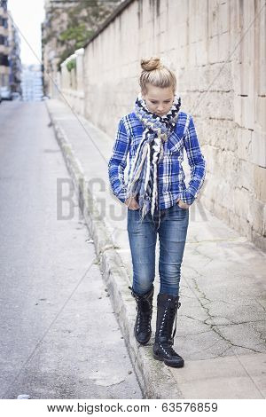 A Teenager Wandering The Streets, Hands In Her Pockets