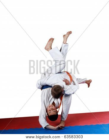 Athletes performing a judo throw
