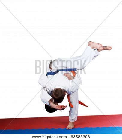 Little athletes perform judo throw