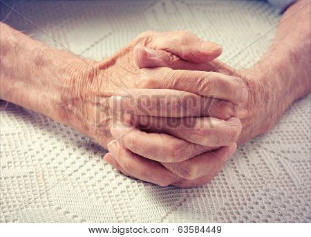Old people holding hands.