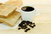 foto of margarine  - Delicious breakfast with fresh hot coffee and whole grain bread - JPG