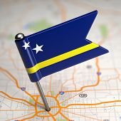 stock photo of curacao  - Small Flag of Curacao on a Map Background with Selective Focus - JPG