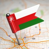 stock photo of oman  - Small Flag of Oman on a Map Background with Selective Focus - JPG