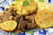 stock photo of tagine  - Moroccan sweet potato and beef tagine closeup on a plate - JPG