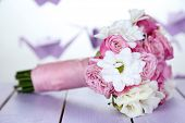 Beautiful wedding bouquet on table on bright background