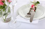 Table setting with spring flowers close up