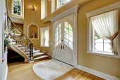 foto of staircases  - Beautiful high ceiling entrance hall with staircase and decorated niches in the walls - JPG