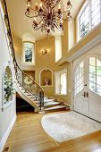 stock photo of niche  - Beautiful high ceiling entrance hall with staircase and decorated niches in the walls - JPG