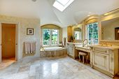 image of bathroom sink  - Spacious luxury bathroom with high vaulted ceiling and velux window - JPG