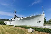 picture of battleship  - The battleship in the garden and blue sky - JPG