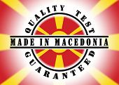 stock photo of macedonia  - Quality test guaranteed stamp with a national flag inside Macedonia - JPG