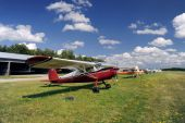 stock photo of cessna  - Red airplane moored on the airfield in nice sunny weather - JPG