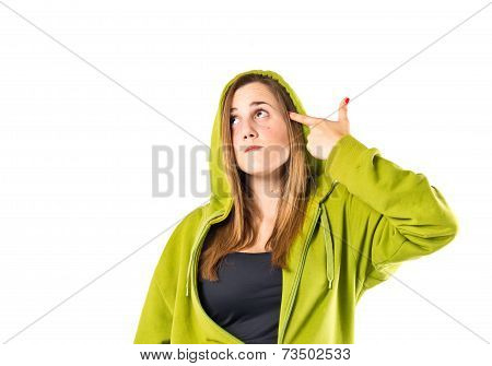 Young Girl Making Suicide Gesture Over White Background