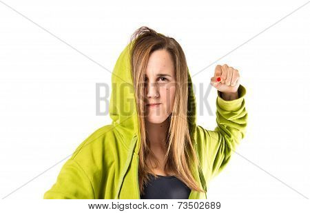 Young Girl Giving Punch Over Isolated White Background